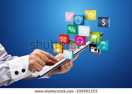 Touchscreen tablet pc with cloud of colorful application - stock photo