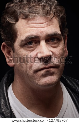 Tough adult man with serious expression - stock photo