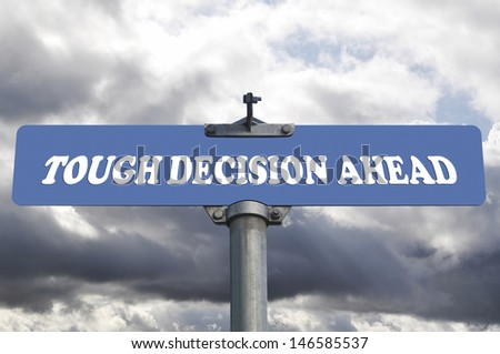 Tough decision ahead road sign - stock photo