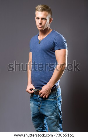 Tough guy, portrait of muscular fit young man. - stock photo