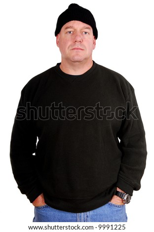 Tough Looking Man Dressed in Black with Beanie - stock photo