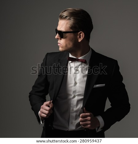 Tough sharp dressed man in black suit  - stock photo
