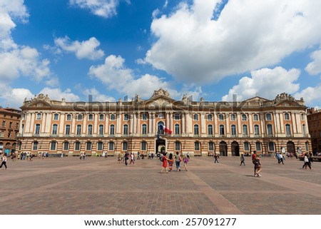 TOULOUSE, FRANCE - JULY 21, 2014: Tourists and locals pay a visit to the Capitole de Toulouse. The Capitole the Toulouse was built in 1190. - stock photo