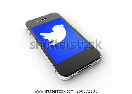 Tourin, Italy - March 14, 2015: Black Smart Phone with Twitter Symbol on the white Table. - stock photo