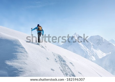 Touring skier in the alps - stock photo