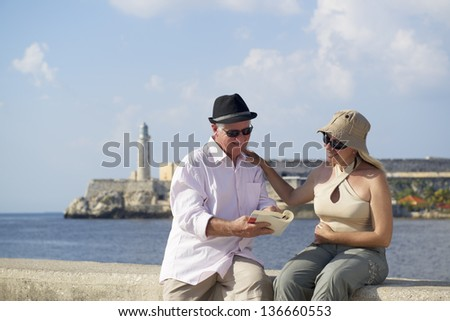 Tourism and active retirement with elderly people traveling, senior couple having fun on holidays in Havana, Cuba - stock photo