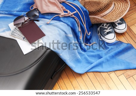 tourism background. Suitcase with things for the trip, money, tickets, passport - stock photo