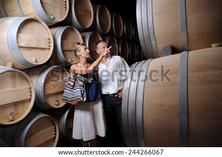 Tourism-Couple visiting a castle in the Bordeaux vineyard - stock photo
