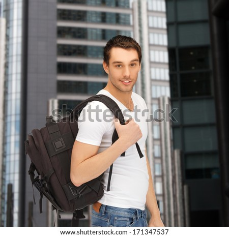 tourism, education and vacation concept - travelling student with backpack outdoor - stock photo