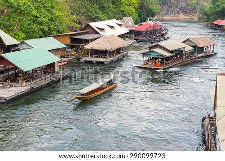 Tourism on the floating house rafting  at the river Kwai,  Kanchanaburi ,Thailand.  - stock photo