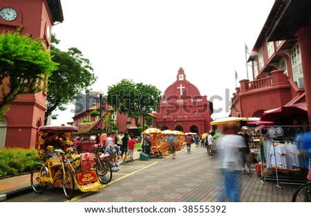 Tourist activity in front Christ Church. Christ Church is in the main square adjacent to Stadthuys, Melaka, Malaysia. - stock photo