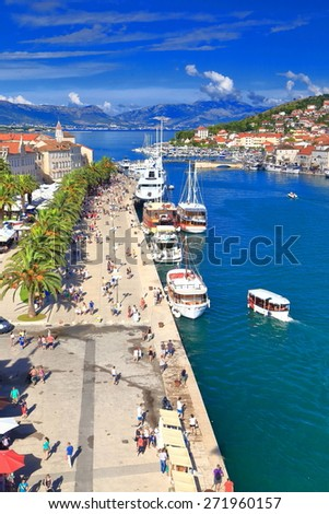 Tourist boat approaching busy pier of old Venetian town, Trogir, Croatia - stock photo