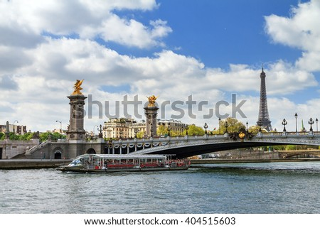 Tourist boat at the river Seine at the pont Alexandre III in Paris, France - stock photo