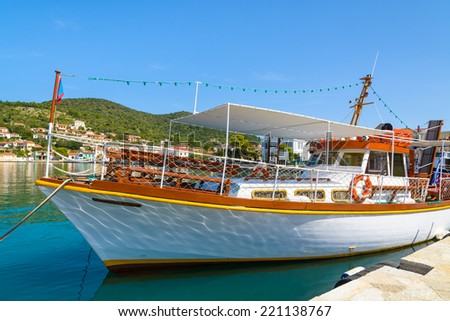 Tourist boat in port of Vathy on Ithaka island, Greece - stock photo