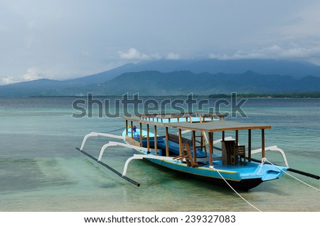 Tourist boat on Gili islands near the Bali island. The most populat tourist destination in Indonesia, Nusa tenggara. - stock photo