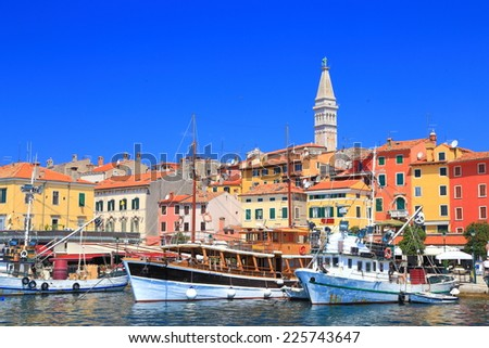 Tourist boats in the harbor of Venetian town near Adriatic sea, Rovinj, Croatia - stock photo