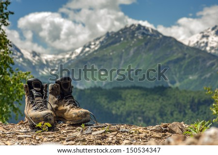 tourist boots and mountain on summer time - stock photo