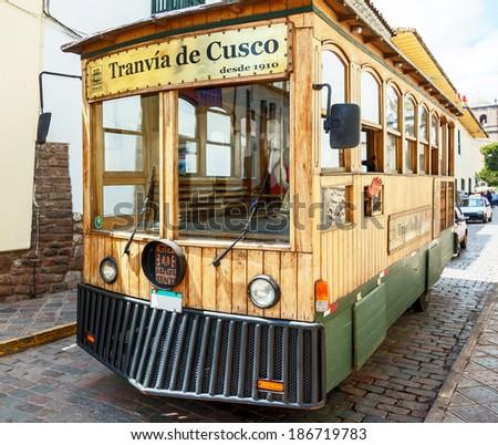 Tourist bus stylized vintage tram - Cusco, Peru - stock photo