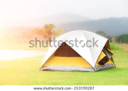 Tourist camping tent in the mountain of Thailand - foggy in a morning - stock photo