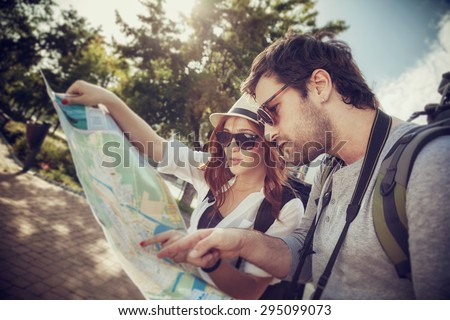 Tourist Couple In The City Browsing Map - stock photo