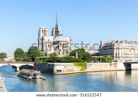 tourist cruise in River Seine Paris with Cathedral Notre Dame Reims Champagne - stock photo
