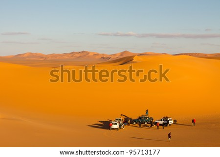 Tourist group in the sand sea of the Sahara Desert, Libya - stock photo