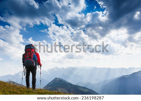 Tourist high in the mountains. Sport and active life concept - stock photo