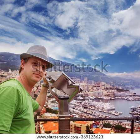 Tourist in Monaco looking at the Port Hercules area with yachts - stock photo
