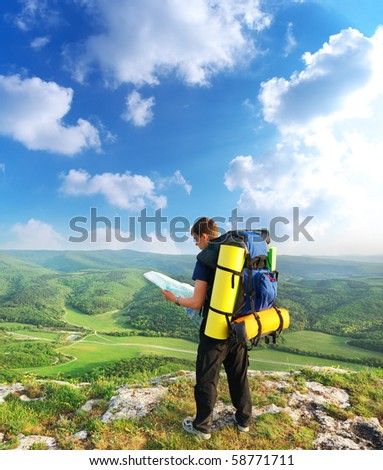 Tourist in mountain read the map. Element of design. - stock photo