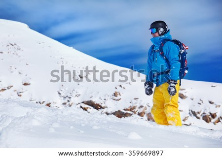 Tourist in snowboard outfit at the winter resort - stock photo