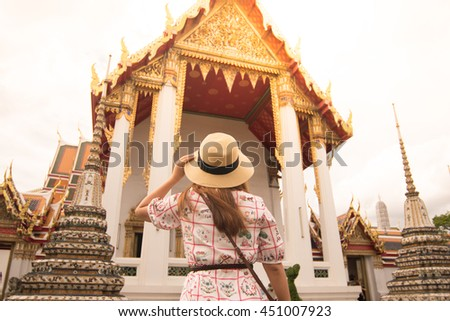 Tourist is sightseeing at Wat Pho in Bangkok, Thailand. - stock photo