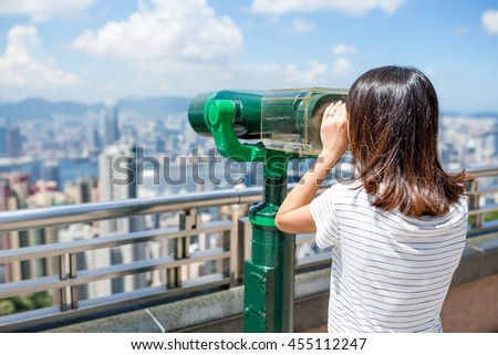 Tourist looking out over the city of Hong Kong from the Peak - stock photo