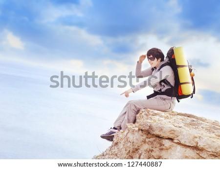 Tourist on mountain - stock photo