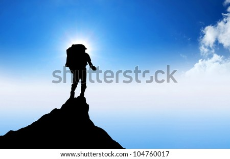 Tourist on mountain top. Sport and active life - stock photo