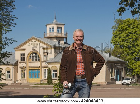 Tourist on the background of the old airport in Ukraine - stock photo