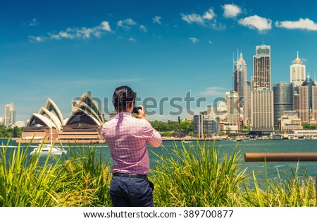 Tourist photographing Sydney skyline, New South Wales, Australia. - stock photo