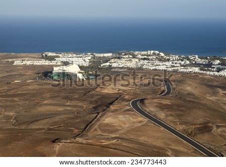 Tourist resort on costa Teguise on Lanzarote one of the Canary islands; Beatriz Costa & Spa hotel situated in the middle between gorgeous Baja de lo Charcos and the picturesque volcano; - stock photo