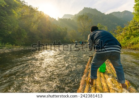 Tourist's raft through the river in Thailand. - stock photo