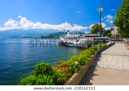Tourist ship on Traunsee lake in summer, Gmunden town, Austria - stock photo