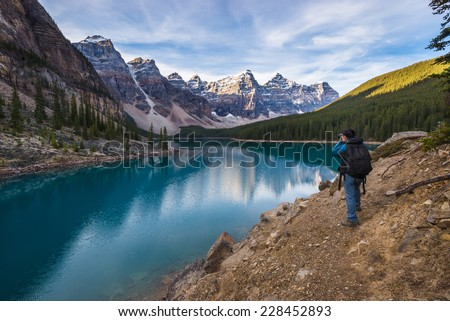 Tourist taking photo at Moraine Lake, Banff national park, Alberta, Canada - stock photo