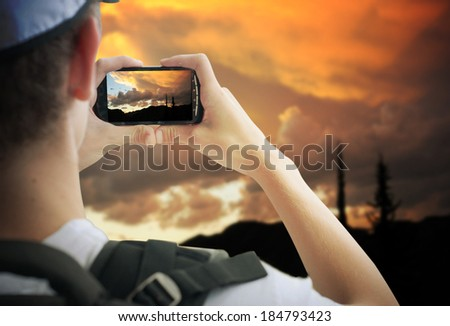 tourist taking photos  with mobile phone  - stock photo