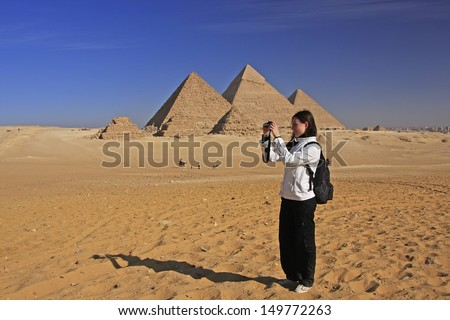 Tourist taking picture at Great Pyramids of Giza, Cairo, Egypt - stock photo