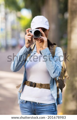 tourist taking sightseeing photos in downtown - stock photo