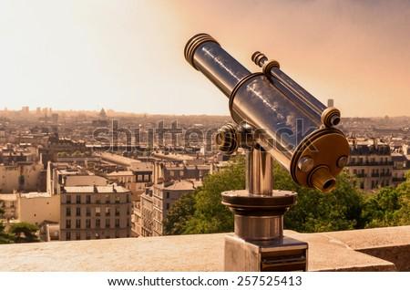 Tourist telescope in the city of Paris - stock photo