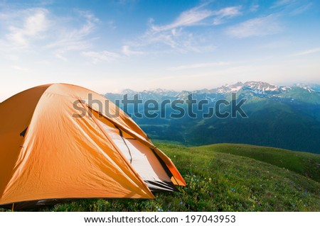 tourist tent camping in mountains - stock photo