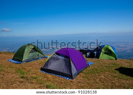 Tourist tent in mountain landscape in Thailand - stock photo