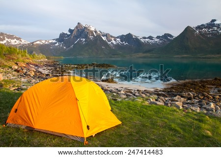 tourist tent on lakeside in mountains,  summertime, Norway - stock photo