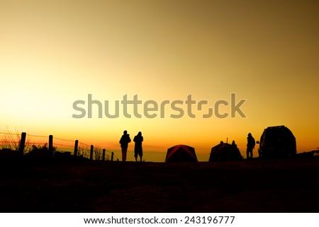 Tourist tent silhouette - stock photo