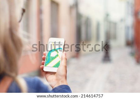 Tourist using navigation app on the mobile phone. - stock photo