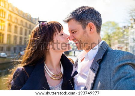 tourist walking couple through city - stock photo